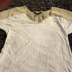 BCBG White & Cream T Amazingly BCBG white and cream t-shirt. Makes Haynes even more boring! Pair it with a skirt, jeans or black silk pant and heels. Excellent Condition. I'll steam before shipping to eliminate wrinkles. BCBG Tops Tees - Short Sleeve