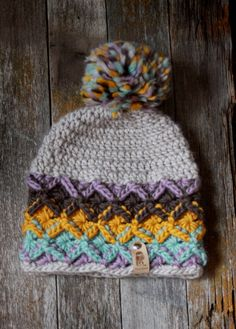 Beautiful, slouchy, chunky Bavarian crochet beanie in pastel teal, purple, mustard, and browns, with Mila Sovas signature label. Handmade with exquisite