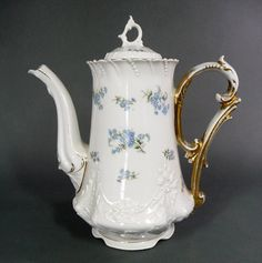 Beautiful Antique Coffee Pot By  C Tielsch Porzelanfabrik, Germany Circa 1870 -1900 With Stunning Embossed Designs and Delicate Blue Floral Sprays