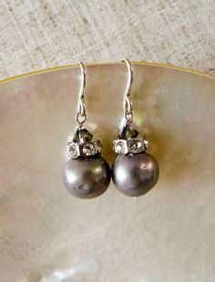 Swarovski Crystal and Gray Mother of Pearl Earrings  Materials: Sterling Silver French Wire, Mother of Pearl, Swarovski Crystal, Rhinestone