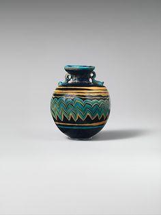 Glass aryballos (perfume bottle) Period: Classical Date: late 6th–5th century B.C. Culture: Greek, Eastern Mediterranean Medium: Glass; core...