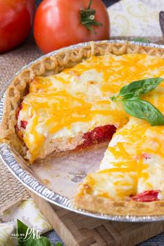 Make the most of those fresh tomatoes with a savory Traditional Southern Tomato Pie recipe. It's full of flavor from two cheeses, fresh sun ripened tomatoes and a buttery pie crust. Easy dinner side or with a salad for lunch.