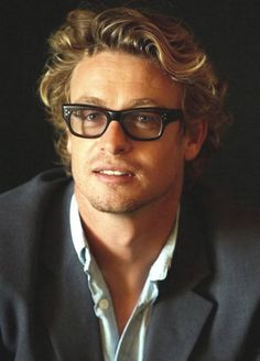 Simon Baker with black glasses... nerdy and handsome. Nice hair too.