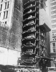 So ahead of it's time: A vertical car park. Too bad they didn't catch on. This is the parking for an apartment building. Push the button for your space and it would rotate around. Drive your car on, and take yourself off. Look at the size of that counterweight.