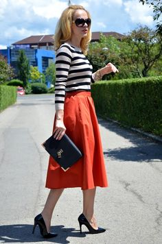 "Orange Midi Skirt & Striped Top- heels up the style.  (Why do we say ""midi skirt"" now?  Basically it is a skirt that isn't street walker short.)"