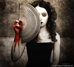 Excellent representation of death with the coins over her eyes and the blood