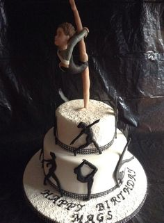 Gymnastics themed cake - all edible, silhouettes are royal icing, model made from modeling chocolate.