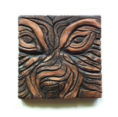 Nice color and surface treatment exposed coil pottery.  Wolf tile - terra cotta clay, 14cm x 14cm