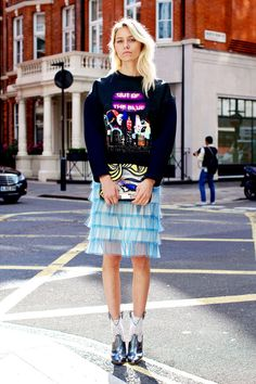 Stylist Tess Yopp wearing a Balenciaga sweater, skirt and shoes by Marc Jacobs.
