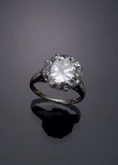 Jewelry & Watches - Sale 1271 - Lot 218 - Art Deco Platinum Solitaire Diamond Ring Circa 1930, 7.45 carats - ADAM A. WESCHLER & SON, INC : AUCTIONEERS AND APPRAISERS - SINCE 1890