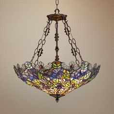 """Floral Garden 3-Light Tiffany Glass Bowl Pendant -   Glass pendants. Frame comes in a bronze finish. Perfect for dining rooms and seating areas alike.  Robert Louis Tiffany      Bronze finish.     Tiffany style glass.     Takes three maximum 72 watt bulbs (not included).     Includes 6 foot chain and 12 foot wire.     25 1/2"""" high.     22"""" wide.     5"""" round canopy.     Hang weight is 12 lbs."""