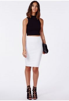Showcase a twist on a classic style with our sleek, scuba fabric pencil skirt. In a smooth stretch material that will flatter and hold your curves perfectly. Team with a stack of bracelets, crop top and heels for ultra modern chic.  Appro...