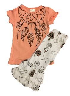 Our baby girls' coral dream catcher capri outfit is absolutely stunning! The top is cap sleeve with a dreamcatcher on the front. The ruffled capri pants have arrows, dreamcatchers, and feathers. Indian print has proven to be a hot seller this summer! Little girls seem to fall in love with this outfit! It's perfect for back to school and every day wear. Get your size while selections are still good!