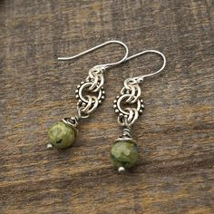 """Green dangle earrings, sterling silver French hooks, rhyolite beads, 1 3/4"""" long Amber Earrings, Amber Jewelry, Wire Earrings, Pendant Earrings, Metal Jewelry, Boho Jewelry, Earrings Handmade, Sterling Silver Earrings, Beaded Jewelry"""