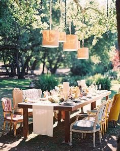Beautiful outdoor reception with a variety of vintage chairs. #wedding #tablescape