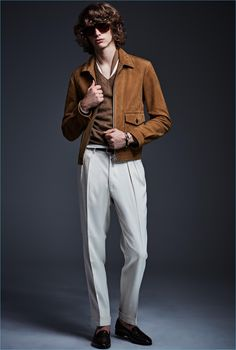 Designer Tom Ford turns out a brown suede jacket as part of his spring-summer 2017 collection.
