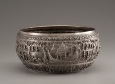 A Large Burmese Silver Ceremonial bowl with Jataka story. Early-mid 20th century.