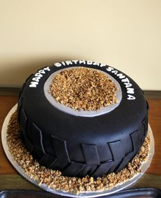 "Monster truck tire cake - 12"" cake with black fondant.  I used cookie crumbs for the dirt."