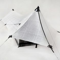 Echo I Cuben Fiber Ultralight Shelter System by Hyperlite Mountain Gear.  Weighs in at 1.43 1bs. per HMG's spec sheet.  Looks like a neat set-up that would perform well for lightweight backpacking adventure!