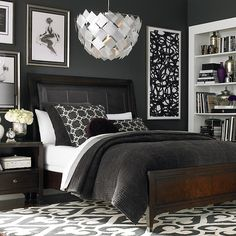 Love the contrast of the charcoal and white in this Cosmopolitan bedroom setting by Bassett Furniture.