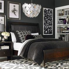 love the art, the dark wood floors, the rug