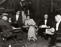 Loretta Young, director Edward H. Griffith, Tyrone Power, Adolphe Menjou and Charles Winninger on the set of Cafe Metropole (1937)