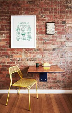 Mesh chair from Bludot, wallmounted table made by Casey's stepbrother, Mark Miller aka Anachronated Design. on wall – framed Able  Game tea towel, Jai Vasicekwall tile.  Photo - Annette O'Brien, styling – Alana Langan of Hunt  Bow.