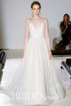 Brides.com: . Style 9661, ivory cashmere tulle ball gown with delicate floral embroidery throughout the skirt, V-neck ballerina bodice of sheer, draped tulle over lace with double spaghetti straps, Alvina Valenta