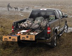 Orvis' new TruckVault storage drawer systems for pick-up trucks.  Has teakwood drawers, LED lighting and nice brass accents.  Keep your stuff safe.