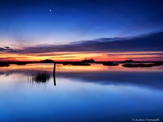 Jo Ann Tomaselli ~ Fine Art Photography A sliver of a moon appears in the blue-hour dawn as sunrise breaks the horizon. A long exposure paints the sky deep blue and the water silken. Mother Nature ...