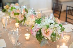 34 BEST LOWCOUNTRY CENTERPIECES - White hydrangeas, peach roses and ranunculus centerpieces by Sara York Grimshaw Designs at Rebecca + Christian's Kiawah Island River Course wedding photographed by Captured by Kate Photography.