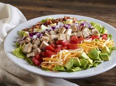 COBB SALAD Mixed greens topped with grilled chicken, avocado, tomatoes, red onions, egg, smoked bacon and Monterey Jack and cheddar cheeses. Served with choice of dressing.†*