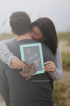 Here is a great idea for a Save the date photograph on the beach! Beach engagement shoots are a lot of fun and there are many ways to get creative with it!