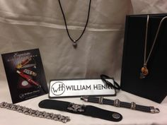 William Henry Studio just recently put out a line of Men's jewelry that includes bracelets, necklaces with pocket knives on the end, and even key chains!!