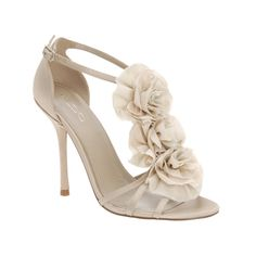 """These high-heeled sandals with a chiffon flower-detail are so elegant and perfect for spring. They are great for a super feminine look and would match almost any color dress. """"Dine"""" … Read more →"""