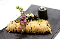 This link is about 50 Best Asian Restaurants but I just pinned it because I loved the presentation of the noodles here -- wrapped in a neat bundle. How lovely!