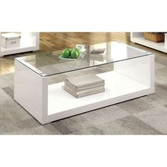 A design that will instantaneously create a modern atmosphere, this coffee table features a gorgeous high gloss finish that is emphasized by the clear glass top. The U-shaped frame creates a handy open bottom shelf that acts as a storage or display area.