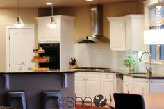 Want to paint my cabinets white like this and add crown molding to the tops!