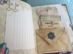 Journal page idea, envelope pocket with tags and ephemera