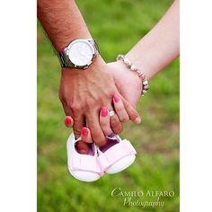Everyone loves tiny shoes! | 38 Insanely Adorable Ideas For Your Maternity Photo Shoot