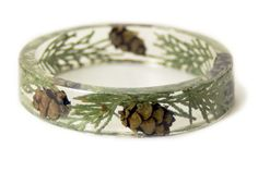 Cedar Forest Resin Bangle / This lightweight Slip on style Bangle by ModernFlowerChild is made with genuine cedar leaves and acorns embedded into Crystal Clear Resin and Shaped into a unique and stylish piece.