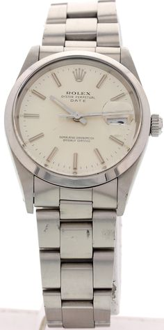Men's Vintage Rolex Oyster Perpetual Date 15000  - Men's vintage Rolex Oyster Perpetual Date from 1975. Stainless steel 34mm case. Oyster stainless steel bracelet; will fit a 7.5 inch wrist.  Stainless steel case & bracelet material. Silver dial & date display.  Automatic movement.