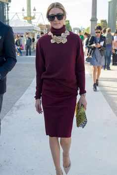 Olivia Palermo  En route to the Nina Ricci show, Olivia Palermo looks decadent in a claret wool pencil dress and ornate neck piece.