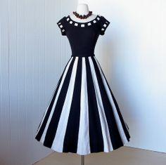 vintage 1950's dress ...figure flattering BLACK & WHITE vertical striped linen full skirt swing pin-up party dress. $170.00, via Etsy.