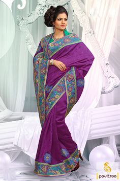 Embellished with lace patti, resham and embroidery works. The bhagalpuri and dhupion made purple turquoise designer party wear Saree is attractive in looks.