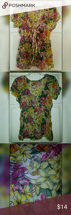🔴SALE 🎁 GUESS JEANS Sheer Floral Blouse 🔴COLUMBUS DAY SALE-  2 DAYS ONLY🎁  Very feminine sheer floral blouse by GUESS  Cute ruffles around the neck line, sleeves, & down the center. The center of the blouse can be adjusted to your size with the cross tie.   Excellent condition with the exception of the elastic of one sleeve appears to be a little more stretched out than the other one. It still has stretch & should not make any difference while wearing but I point out anything that I…