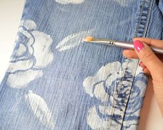 studs and pearls: diy: Floral Jeans- or use this for something else... NEED: - Large flower/rose stencil - Jeans / Other Fabtic - White fabric paint - Flat sponge brush - Masking tape & thin paintbrush