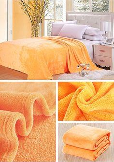 Dekoračná deka a prikrývka pomarančovej farby