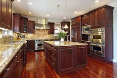 kitchen cabinets wood primal bars mahogany cabinet pictures in luxury home with dark cherry cabinetry flooring and granite island