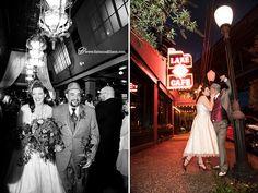 Lake Union Cafe Seattle wedding, tea length wedding dress, grey tux,  Bride and groom kissing under street lap outside of  Seattle wedding venue Lake Union Cafe